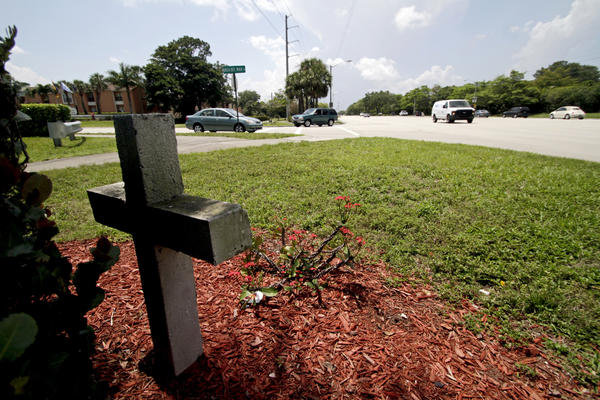 A concrete cross is pictured at the southeast corner of the intersection of West Palmetto Park Road and Boca Del Mar Drive on Monday. Shoshana Rachel Stern, 12, of West Boca, died Sunday after a 2005 Ford Mustang driven by Marvin Stanley James IV, 24, of West Palm Beach hit her as she crossed West Palmetto Park Road on her skateboard, according to the Palm Beach County Sheriffs Office.