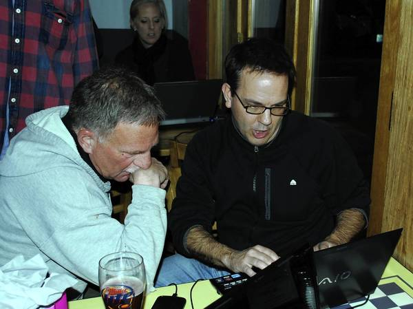 Paul Wehner, right, of Community Leaders Educating and Advocating for the 113 Referendum, watches his laptop April 9 as the election results are slowly revealed after the polls closed.