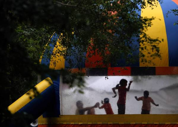 Caroline Lindquist, of Chicago, plays in an inflatable bounce house. The number of children injured while playing in bounce houses, moon walks and similar attractions is reaching an epidemic, says Dr. Gary Smith, a pediatrician and researcher.