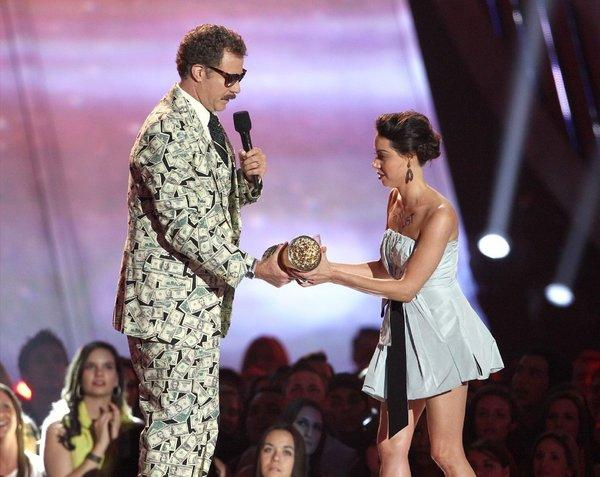 Aubrey Plaza tries to pull a Kanye West on Will Ferrell during the MTV Movie Awards on Sunday.