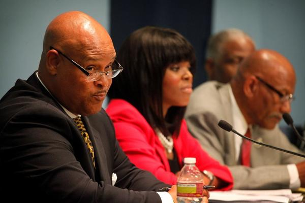 Former Compton Mayor Omar Bradley, left, speaks at a mayoral candidates' forum March 30 in Compton. Bradley is one of 11 candidates vying to become the city's next mayor.