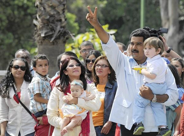 Interim President Nicolas Maduro appears with his grandson outside a polling station in Caracas, Venezuela, before casting his vote. He won by 1.5 percentage points.