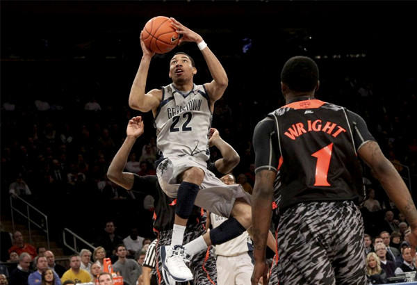Georgetown's Otto Porter Jr. (22) goes up for a shot against Cincinnati.