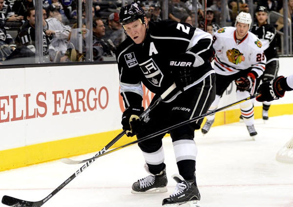 Kings' Matt Greene clears the puck during a game against the Chicago Blackhawks.