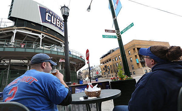 Abby Lochotzki and Nic Cross, who live near Wrigley Field, eat lunch at Murphy's Bleachers at the corner of Sheffield and Waveland avenues.