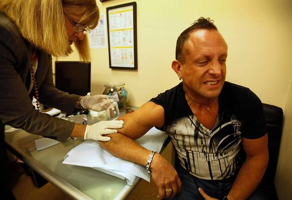 Nurse Karen Haughey administers a bacterial meningitis vaccine to Steve Oratowski, 46. There's been an outbreak of the disease in New York and a lawyer died recently in West Hollywood.