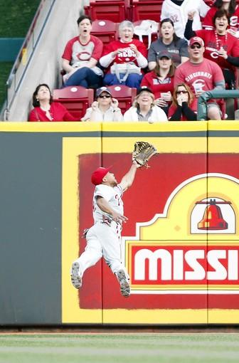 Phillies center fielder Ben Revere makes a diving catch on a ball hit by Cincinnati's Todd Frazier during the second inning at Great American Ball Park.