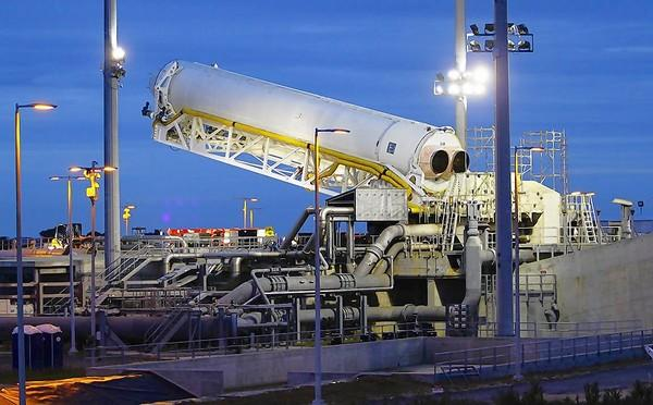 Orbital Sciences' Antares rocket is on the launchpad at NASA's Wallops Flight Facility in Virginia. The rocket is set to carry a dummy cargo capsule weighing about 8,300 pounds to about 160 miles above Earth.