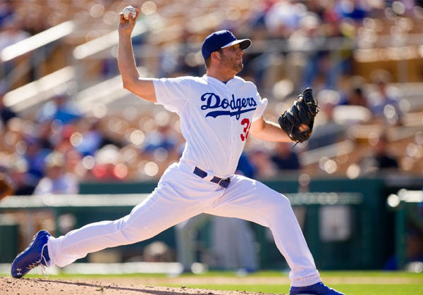 Dodgers pitcher Shawn Tolleson pitches during a spring training game against the Chicago Cubs.