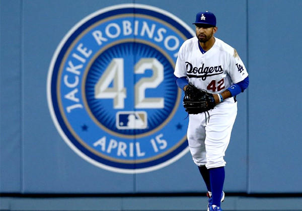 Dodgers center fielder Matt Kemp wears No. 42 as he plays center field near a sign on the wall for Jackie Robinson Day.