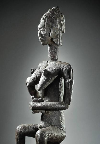 """Gwan"" mother and child figure."