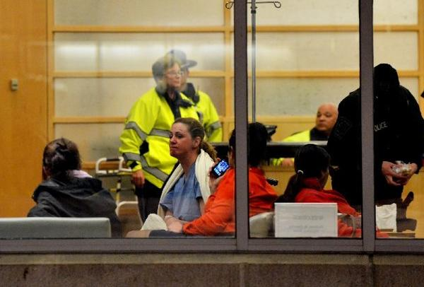 People wait in the main lobby of Brigham and Women's Hospital in Boston.
