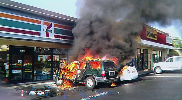The SUV burns in Long Beach with a 63-year-old man trapped inside.