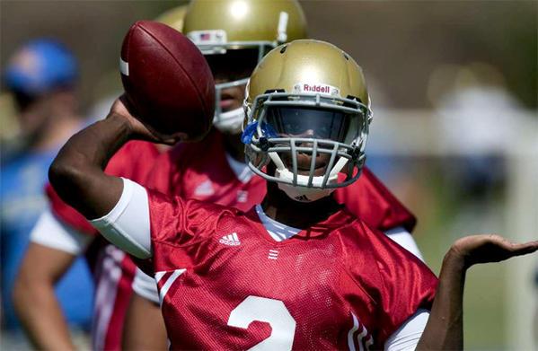 UCLA quarterback Devin Fuller makes a pass during practice last summer.