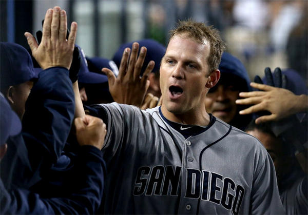 San Diego Padres pitcher Eric Stults celebrates after hitting a three-run homer against the Dodgers.