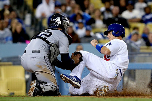 Dodgers catcher A.J. Ellis is thrown out at the plate while trying to score on a groundout.