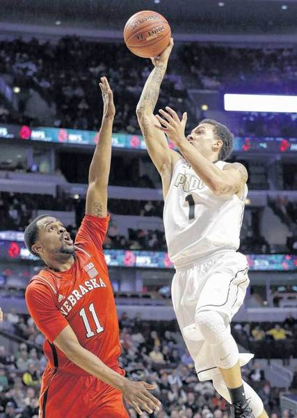 Purdue's Anthony Johnson shoots over Nebraska's Jordan Tyrance during a Big Ten Tournament game last month.