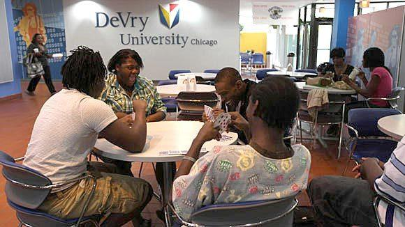 Students play cards at lunchtime at DeVry's Chicago Campus.