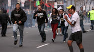 NEW YORK (AP) — The Boston Marathon explosions and their aftermath were captured in chilling images that ran as relentless tape loops of terror online and on TV networks Monday, a sickeningly familiar routine in an age of violence designed for maximum impact.