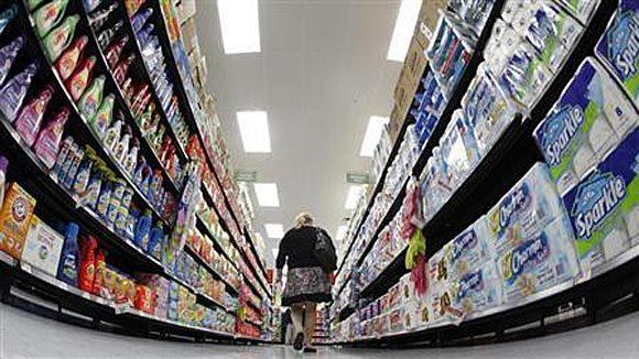 A shopper walks down an aisle in a newly opened Walmart Neighborhood Market in Chicago in 2011.