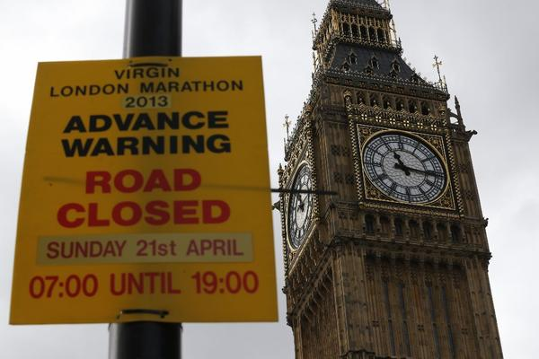 With Big Ben in the background, a sign warns of road closures for the coming London Marathon.