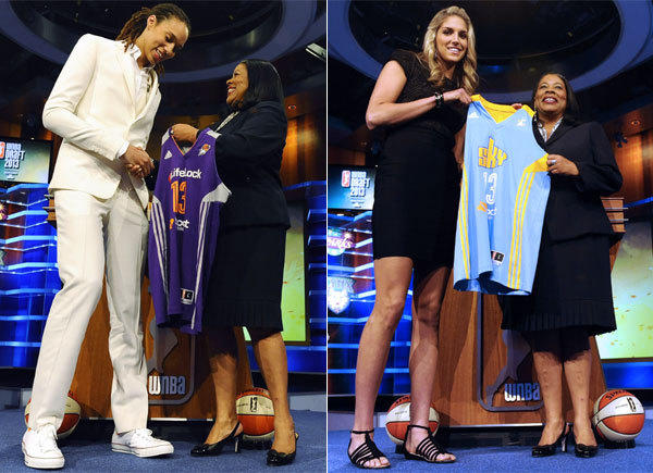 Baylor's Brittney Griner, left, and Delaware's Elena Delle Donne receive their new WNBA jerseys from league president Laurel Richie on Monday night.