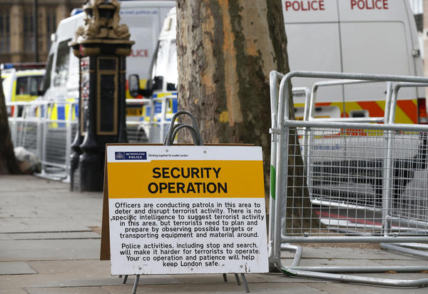 A sign Tuesday along the route of the London Marathon warns of security patrols. British police are reviewing security plans for Sunday's marathon, the next major international marathon after Boston's.