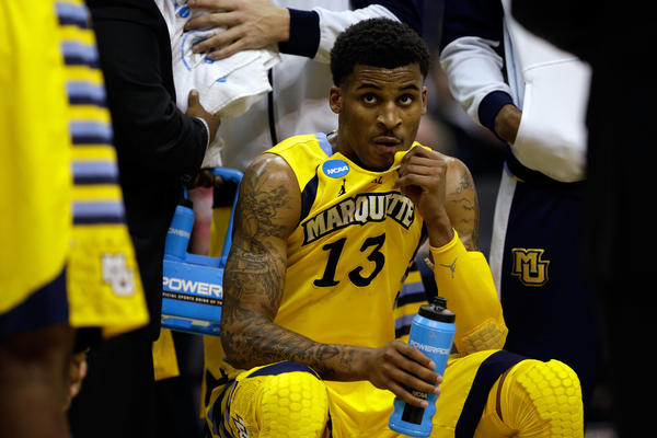 Vander Blue of the Marquette Golden Eagles looks on from the bench against the Syracuse Orange during the East Regional Round Final of the NCAA tournament last month.