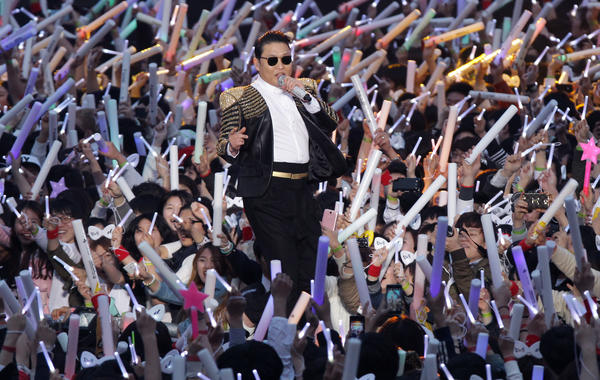 Psy performs at Olympic Stadium in Seoul on Saturday.