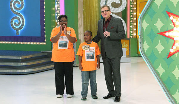 "Drew Carey, right, with Christian Reed and her son, Carter, on ""The Price Is Right"""