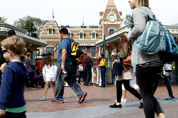 Disneyland's popular Space Mountain and California Adventure's Soarin' Over California have been temporarily closed after the company received citations from state regulators. Above, visitors entering the park last month.