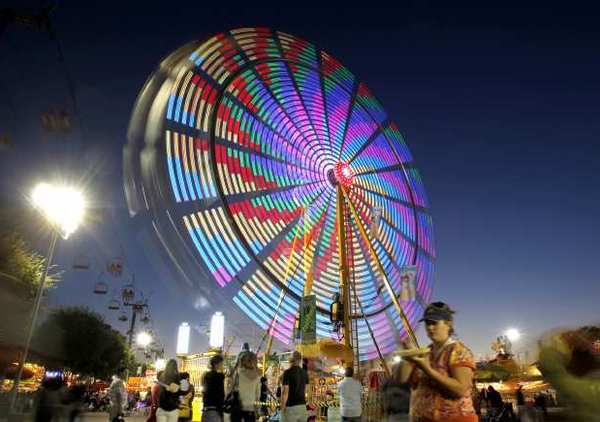 The Ferris wheel lights up the night sky at the 2012 Orange County Fair.