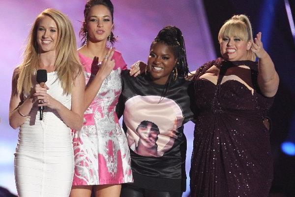 "Kelly Jakle, from left, Hana Mae Lee, Brittany Snow, Anna Camp, Alexis Knapp, Ester Dean and Rebel Wilson accept the award for best musical moment for ""Pitch Perfect"" at the MTV Movie Awards last weekend."