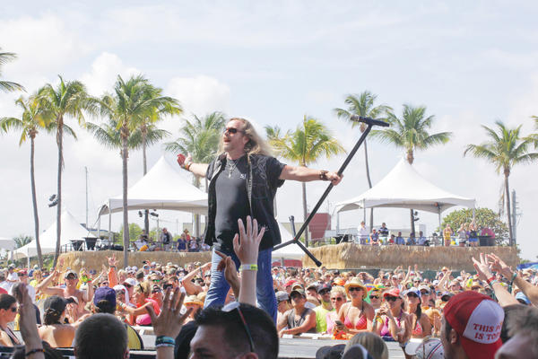 "Lynyrd Skynyrd performs during the Rock The Ocean's ""Tortuga Music Festival."" The event, benefiting Rock the Ocean Foundation and Guy Harvey Foundation, featured country and rock musicians and raised awareness about marine conservation. Photo by Kara Starzyk."