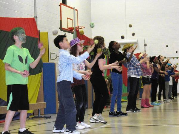 Dozens of students from grades three through five participated Friday in the Millennium Elementary School's 13th annual juggling show.