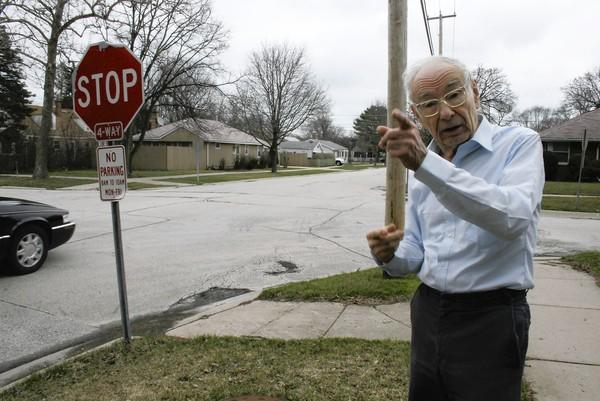 William Lill, 85, of Glenview, talks about traffic increasing over the years outside of his house on Colfax Avenue on April 12. Lill, along with several of his neighbors, expressed concerns over the safety of pedestrians and children in the area at a neighborhood meeting on the subject on April 10.