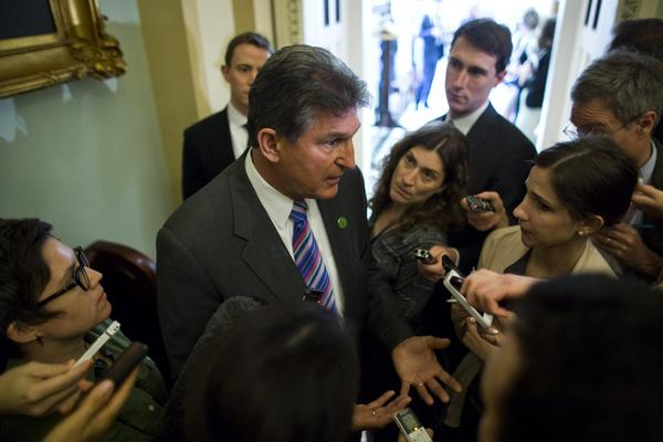 Sen. Joe Manchin (D-W.V.) speaks to the media about the background check bill at the Capitol in Washington.
