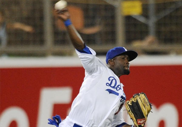 Dodgers outfielder Tony Gwynn Jr. throws the ball to the infield during a spring training game against the Kansas City Royals.
