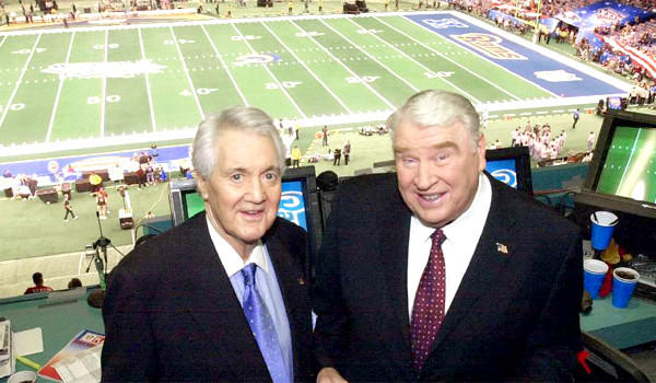 Legendary football broadcaster Pat Summerall, left, pictured with with John Madden in the broadcast booth before Super Bowl XXXVI on Feb. 3, 2002, has died. He was 82.