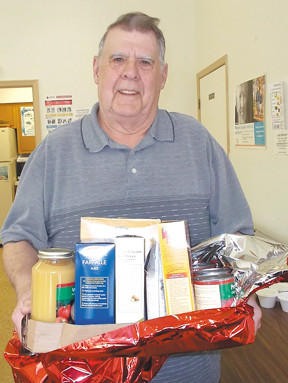 Ron Butts, manager of Williamsport's Park View Knoll Senior Center, was surprised Monday with cake and a package of goodies from day residents to celebrate his 74th birthday.