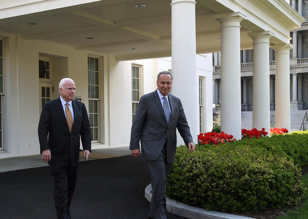 Sen. Charles Schumer (D-N.Y.) and Sen. John McCain (R-Ariz.) walk out of the West Wing of the White House after meeting with President Obama on immigration reform.