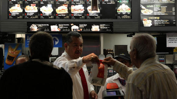 Manager Frank Galvan hands out a meal at a McDonald's in downtown Chicago.