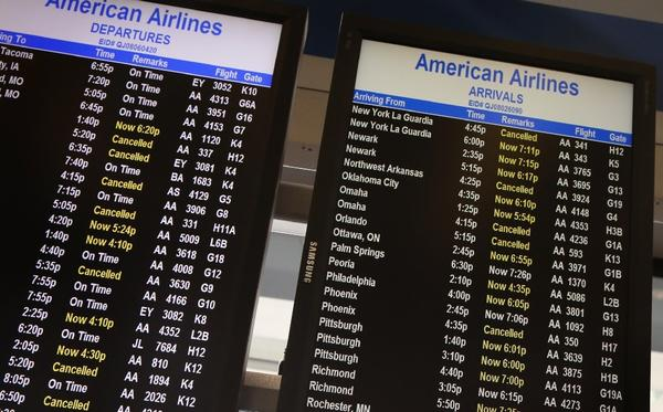 American Airlines' computer problem grounded thousands of passengers Tuesday. The airline says it is fixed. Passengers, however, will need strategies for rebooking.