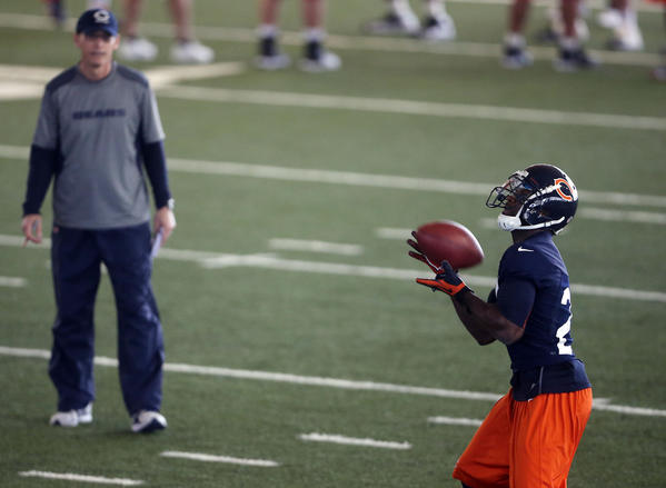 Head coach Marc Trestman watches Devin Hester receive a punt on Tuesday during the Bears minicamp in the Walter Payton Center at Halas Hall.