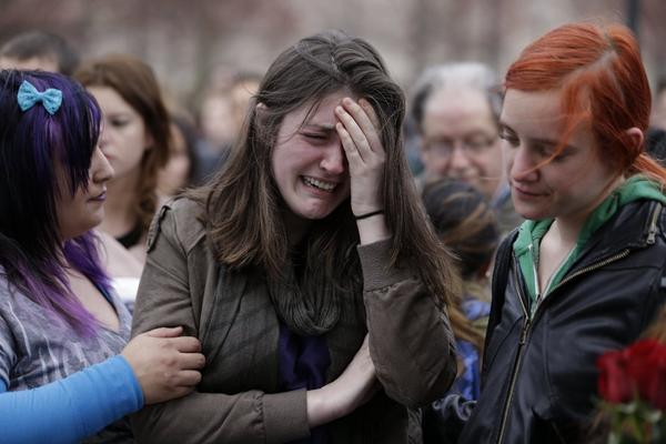 Emma MacDonald, 21, cries during a vigil for the victims of the Boston Marathon explosions at Boston Common.