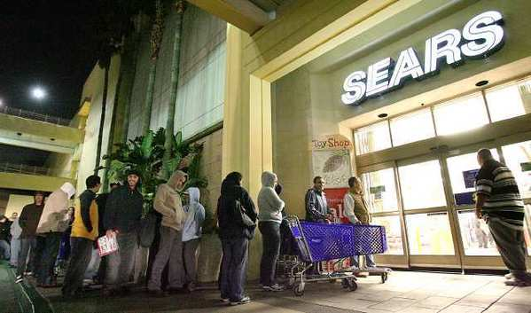 ARCHIVE PHOTO: Customers wait for Sears to open at the Burbank Town Center early in November 2007.