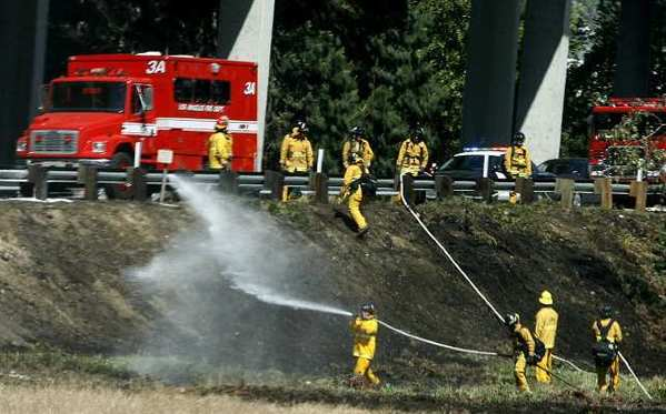 A small brush fire started in the field area between northbound Interstate 5 and westbound 134 in Glendale on Tuesday, April 16, 2013.