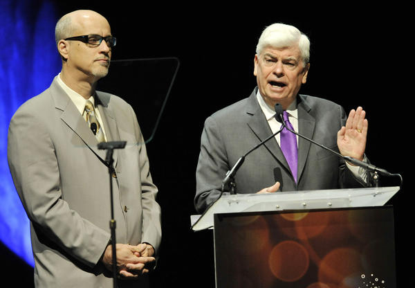 National Assn. of Theatre Owners President and Chief Executive John Fithian, left, joins Christopher Dodd, chairman and CEO of the Motion Picture Assn. of America, at CinemaCon 2013's State of the Industry address at Caesars Palace in Las Vegas.