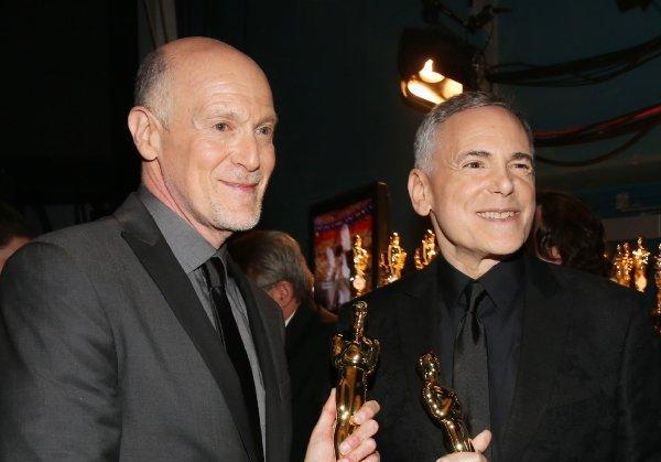 Oscar telecast executive producers Craig Zadan, left, and Neil Meron with statuettes backstage at the Feb. 24 gala.