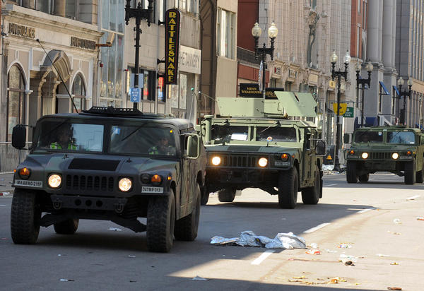 U.S. military Humvees roll down a deserted Boylston Street, which is considered a crime scene after two explosions rocked the Boston Marathon on Monday.